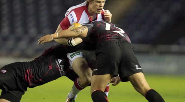 Edinburgh's Sean cox and Ben Atiga (right) tackles Ulster's Andrew Trimble (centre) in the RaboDirect PRO12 rugby union match at Murrayfield Stadium, Edinburgh