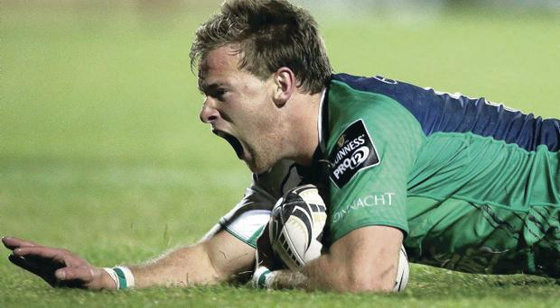 Crossing over: Connacht's Kieran Marmion scores his side's first try