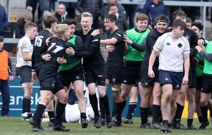 Party time: Campbell College players celebrate at the full-time whistle