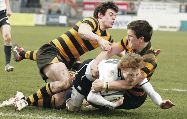 Josh Bingham scores his first of two tries against RBAI during last year's Danske Bank Schools' Cup Final at Ravenhill Brian Little