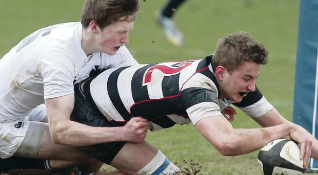 Wallace's Ryan Branagh scores a try despite efforts of MCB's Connor Kelly at Queen's Arena