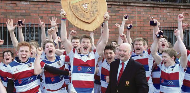 Captain's lift: Timmy Emerson holds aloft the Shield after leading Dalriada to victory