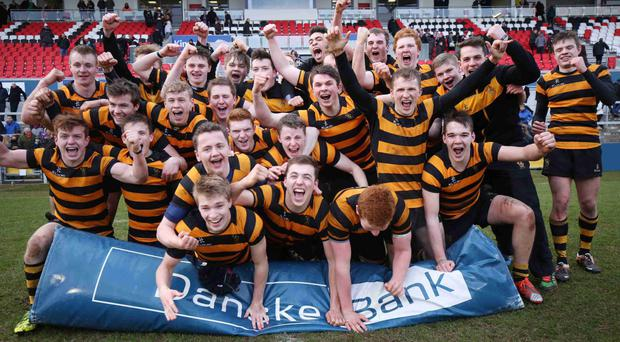 Victory roar: Inst players celebrate their semi-final success and will now contest the Schools' Cup final on St Patrick's Day