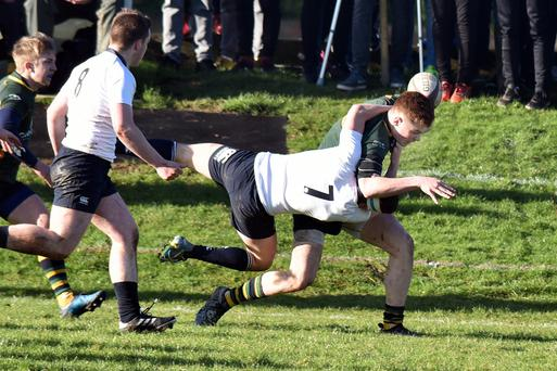Reaching out: Down's Zac Ward is challenged by Matty Loane