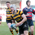 Going over: Inst ace Michael Lowry bags a try at the Kingspan