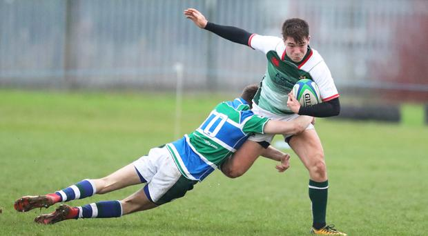Making ground: Jack Harte of Friends School is tackled by Jordan Brown