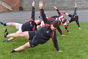 Fitness training: Wellington College players warm-up