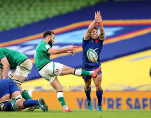 Kick it out: Ireland's Jamison Gibson-Park kicks the ball under pressure from France's Antoine Dupont yesterday