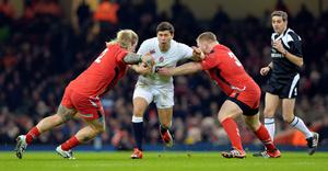Young gun: Wales' hooker Richard Hibbard and prop Samson Lee fail to stop England scrum half Ben Youngs