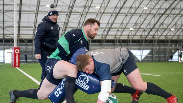 Men at work: scrum coach John Fogarty with Cian Healy and Tadhg Furlong