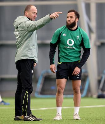 Assistant coach Mike Catt with Jamison Gibson-Park at an Ireland training session