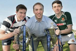 Ireland and Ulster star Stephen Ferris with Wallace captain Callum Irvine and Friends  skipper Jason Hassard with the Six Nations and Triple Crown trophies at Lisburn Rugby Club yesterday