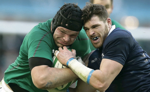 Ireland's Mike Ross attempts to resist the  attention of Sean Lamont of Scotland at the Aviva Stadium last weekend