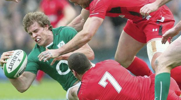 Brought down: Andrew Trimble is tackled by Sam Warburton and Jamie Roberts