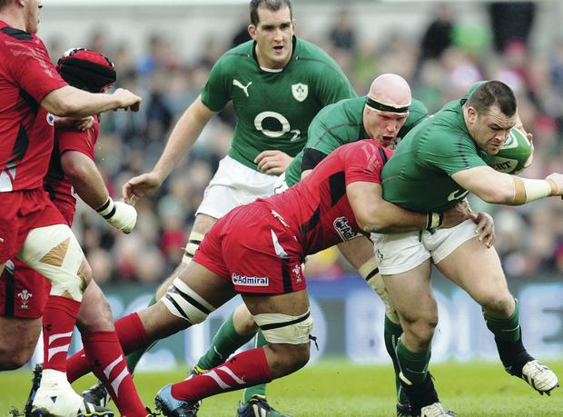 In it together: Cian Healy, on attack against Wales last week, has hailed Ireland's team spirit