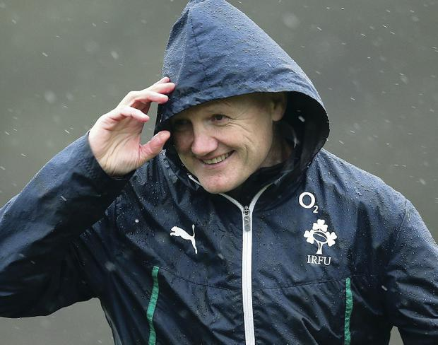 Ireland coach Joe Schmidt tries to take shelter from the elements during yesterday's training session