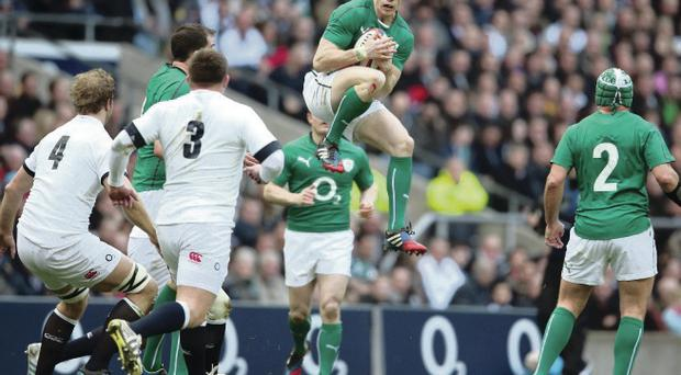 Ulster's Andrew Trimble catches a ball for Ireland in midair against England at Twickenham