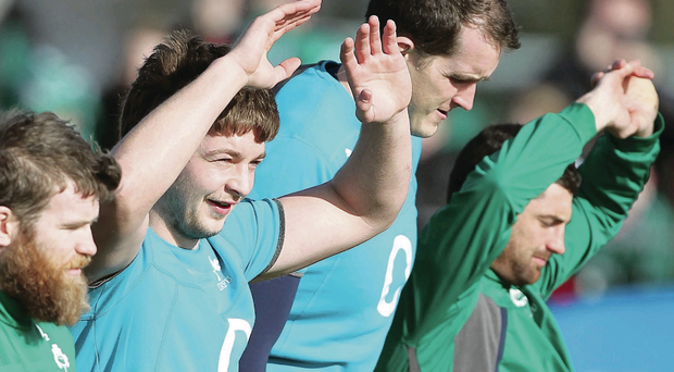 Full stretch: Ireland Iain Henderson (centre) during training in the Ireland camp in Belfast