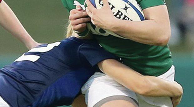 Crunch: Ireland's Jenny Murphy is tackled by Marjorie Mayans