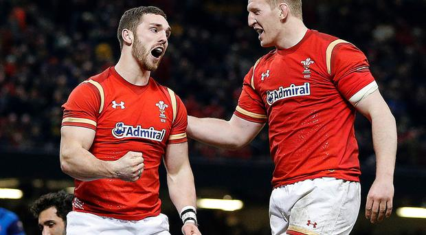 Fist pump: Wales' George North (left) celebrates scoring his team's first try with Bradley Davis