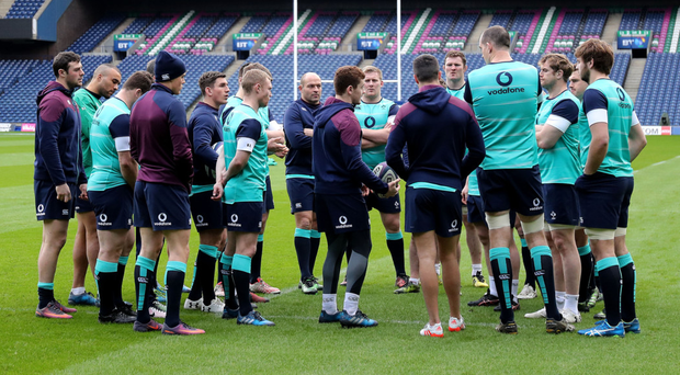 Centre of attention: Ulsterman and starting out-half Paddy Jackson talks to his Ireland team-mates at Murrayfield