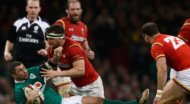 Grounded: Rob Kearney is hit by a crunching Sam Warburton tackle