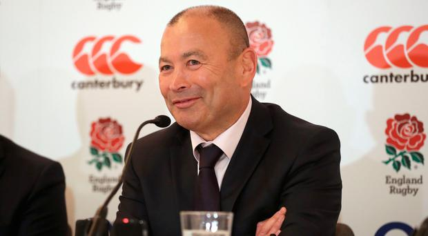 Staying put: Eddie Jones will remain beyond the World Cup