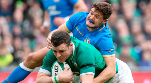 Home comforts: Ireland's Robbie Henshaw is tackled by Italy's Marcello Violi