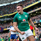 Scoring sensation: Ulster and Ireland ace Jacob Stockdale celebrates bagging one of his tries during the NatWest Six Nations clincher against Scotland in Dublin