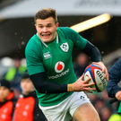 On the run: Jacob Stockdale takes it to England during Ireland's triumph