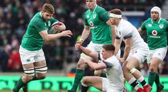 Best foot forward: Ulsterman Iain Henderson charges forward in possession at Twickenham