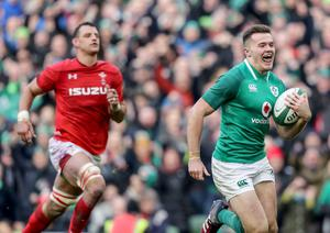 Out of reach: Ireland's Jacob Stockdale races in for his second try against Wales on Saturday