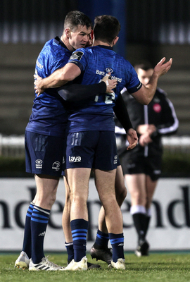 Johnny Sexton celebrates after the game with Hugo Keenan
