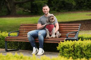 Man's best friend: Ulster and Ireland's John Cooney relaxes with his dog Bonnie yesterday