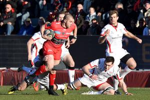 No stopping him: Toulon's Mitchell Drew makes a dash as Ulster stars can only look on