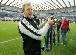 Prize possession: Saracens boss Mark McCall with the European crown