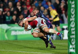 Ulster's Sean Reidy is tackled by the Exeter Chiefs' Gareth Steenson