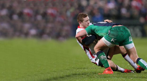 Hands on: Paddy Jackson is halted at the Kingspan Stadium during Ulster's win over Connacht