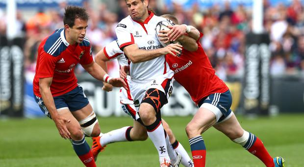 On the run: Louis Ludik comes under pressure from Munster ace Keith Earls at the Kingspan