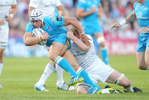 Ulster's Luke Marshall is tackled by Leinster's Tony Ryan