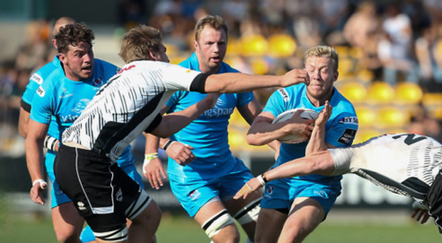 On the charge: Stuart Olding in action