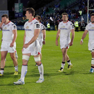 Down and out: Ulster's defeated players trudge off the pitch at the RDS after losing to Leinster in the Pr012 semi-finalKiss