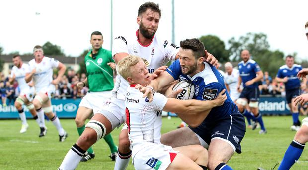 Standing firm: Ulster's Dave Shanahan tackles Barry Daly of Leinster in Navan at the weekend