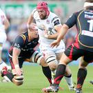 Forward thinking: Ulster's Peter Browne is tackled by the Dragons' Rynard Landman, Ed Jackson and Sam Hobbs