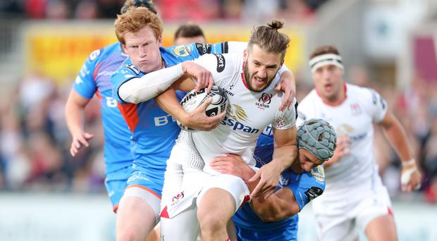 On the run: Stuart McCloskey takes on the Scarlets last night