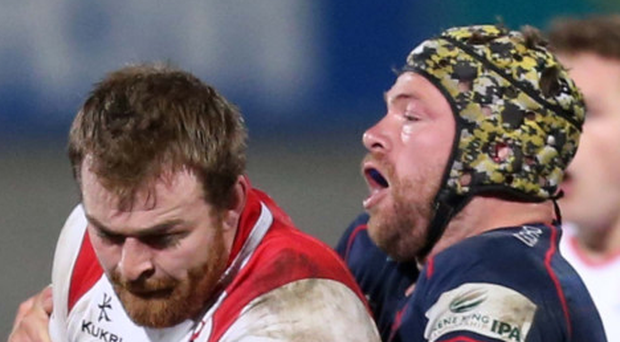 Grapple: Ulster's Lorcan Dow is tackled by Danny Kenny