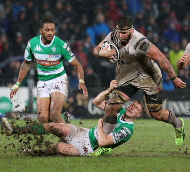Powerhouse: Ulster's Marcell Coetzee charges through the challenge of Treviso's Tommaso Iannone