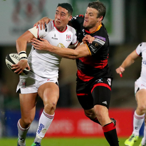 Pitch battle: Ulster's Brett Herron jostles with Pat Howard