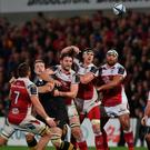 Captain's role: Iain Henderson (third from left) and Robbie Diack of Ulster outjump Joe Launchbury of Wasps