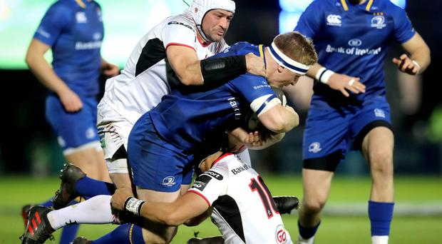 Rough 'n' tumble: Leinster's James Tracy is taken down by Ulster pair Rory Best and Christian Lealiifano